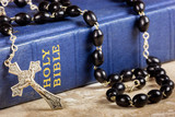 Rosary beads, cross and Bible
