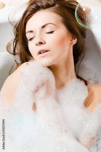 Portrait of the girl sitting in a bath