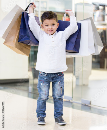 Boy holding shopping bags