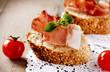 Jamon. Slices of Bread with Spanish Serrano Ham. Prosciutto