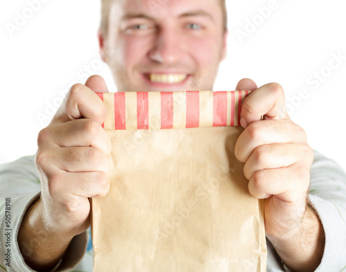 Man holding paper bag