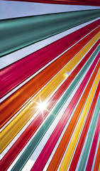 Sun flare through coloured ribbons