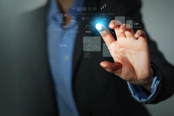 Business man touching display