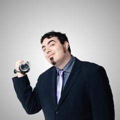 elegant man with video camera