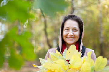 mature woman in autumn