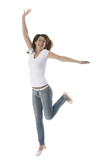 Beautiful young woman jumps for joy