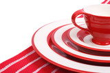 Table setting. Red crockery for striped napkin isolated poster