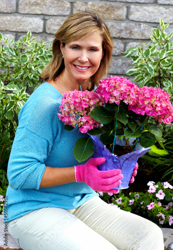 Beautiful gardening woman.