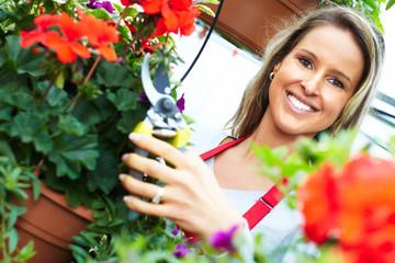 Woman cutting flower.