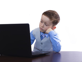 boy in a suit and a laptop