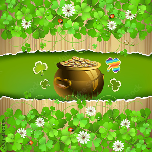 Wood background with clover and pot with coins