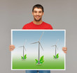 man with picture of wind turbines