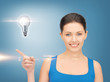 woman showing light bulb on her hand