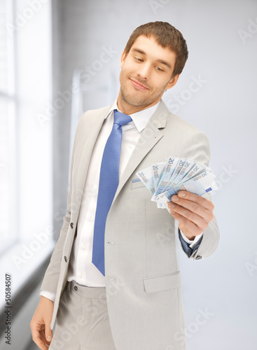 man with euro cash money