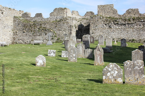 Keuken foto achterwand Olijf A church and graveyard within the walls of a medieval castle