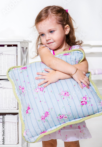 Toddler girl with  pillow