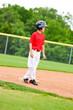 Youth baseball player on third base