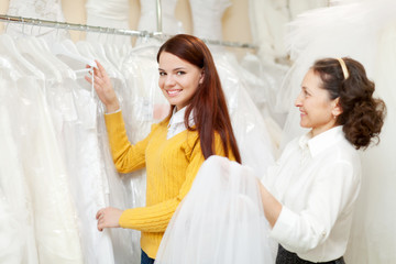 Mature woman with bride at wedding store