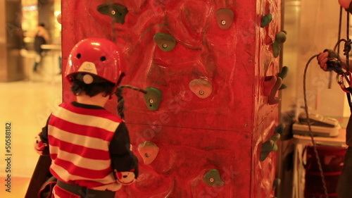 little boy climbing the wall