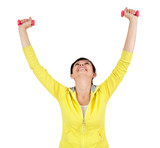cheering woman working out in the gym with dumbbells