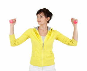 young woman working out with small dumbbells