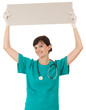 woman doctor keeping  blank billboard above head