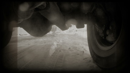 Off-road automobile in motion. Front axle view. GoPro shot.