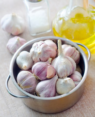 garlic in metal bowl on the table