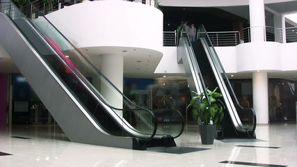 Escalators in shopping center. Timelapse