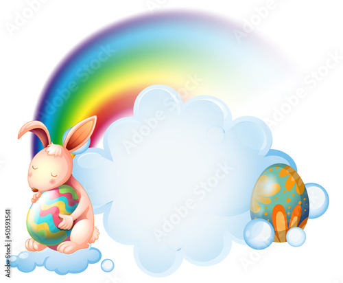 A bunny hugging an easter egg near the rainbow