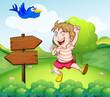 A boy beside a wooden arrow and the blue bird