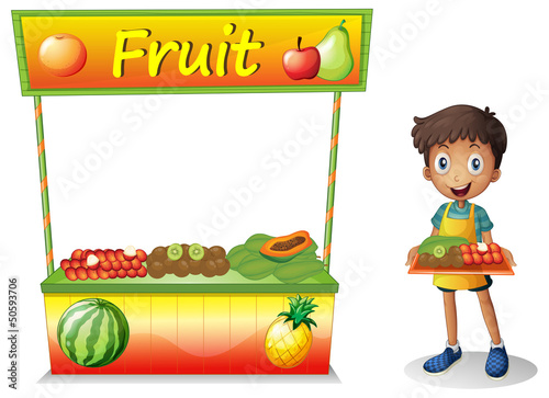 A young boy selling fruits