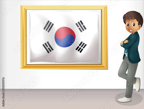 A framed flag of Korea and the young man