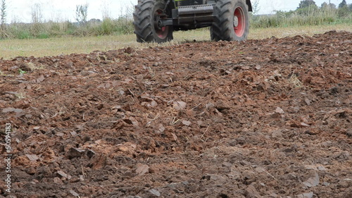 tractor machine closeup plow trench furrow agriculture field