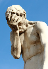 Tuileries Garden in Paris, near Louvre. A facepalm statue.