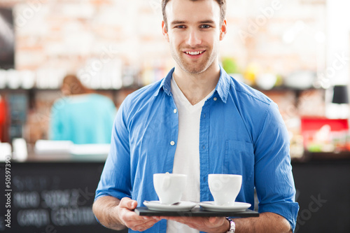 Waiter with coffee on tray