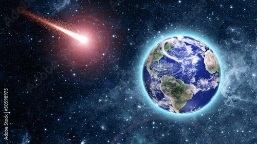 kometa zbliża się do niebieskiej planety w kosmosie