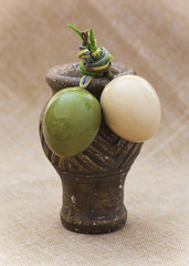 Two ceramic easter eggs and clay vase