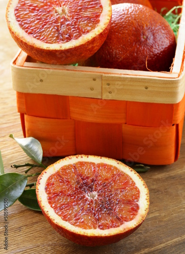 red (bloody) oranges on a wooden plate