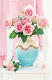Beautiful fresh roses in a ceramic vase.