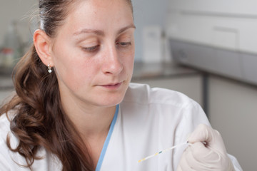 Woman making urine test