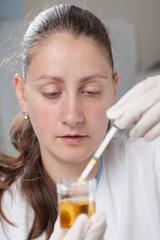 Woman making urine test