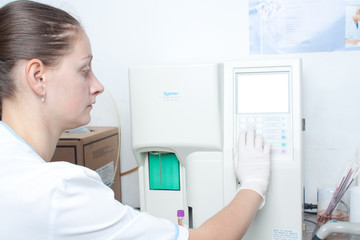 Woman performin hematological test.