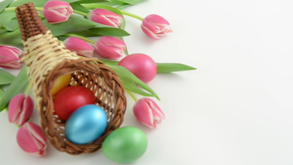 Rack focus of cornucopia basket with tulips and Easter eggs