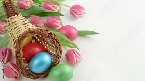 Zoom of cornucopia basket with tulips and Easter eggs