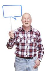 Senior man holding a speech bubble sign smiling