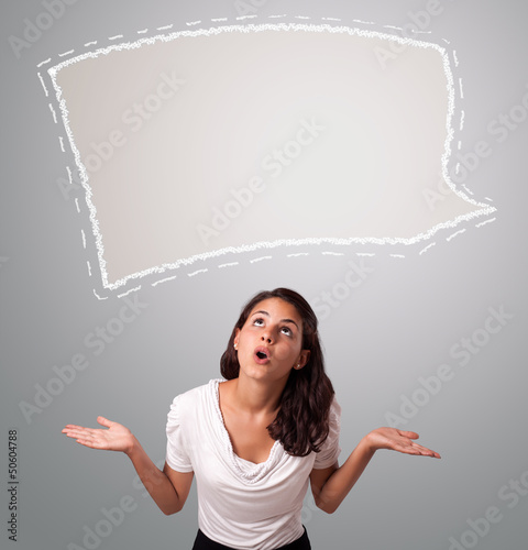 Attractive woman looking abstract speech bubble copy space