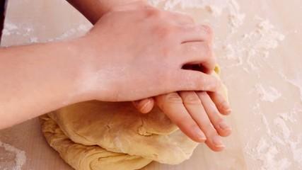 hands kneading bread