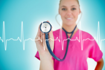 Nurse holding up stethoscope to ECG line