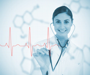 Doctor holding stethoscope up to red ECG line